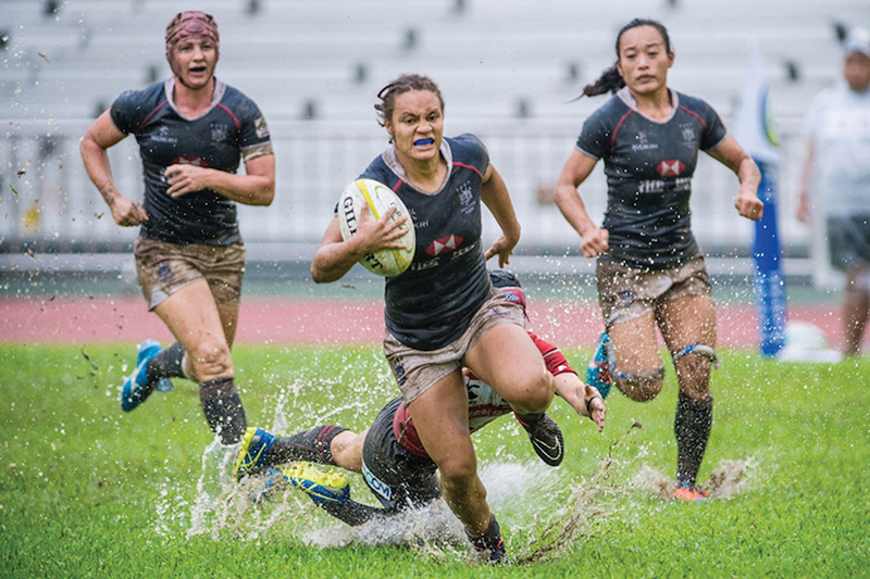 HK ctr Natasha Olson-Thorne storms away for a try v Japan