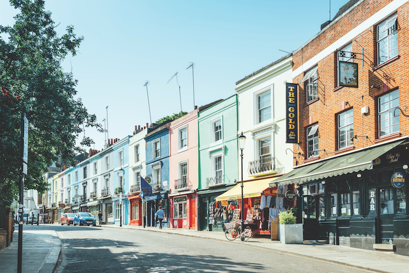 London, United Kingdom - May 25, 2017 : Portobello Road is a street in the Notting Hill district of the Royal Borough of Kensington and Chelsea in west London. It runs almost the length of Notting Hill from south to north, roughly parallel with Ladbroke Grove. On Saturdays it is home to Portobello Road Market, one of London's notable street markets, known for its second-hand clothes and antiques.