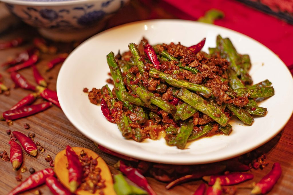 Sichaunese green beans with vegan Omnipork at Chilli Figara in Hong Kong