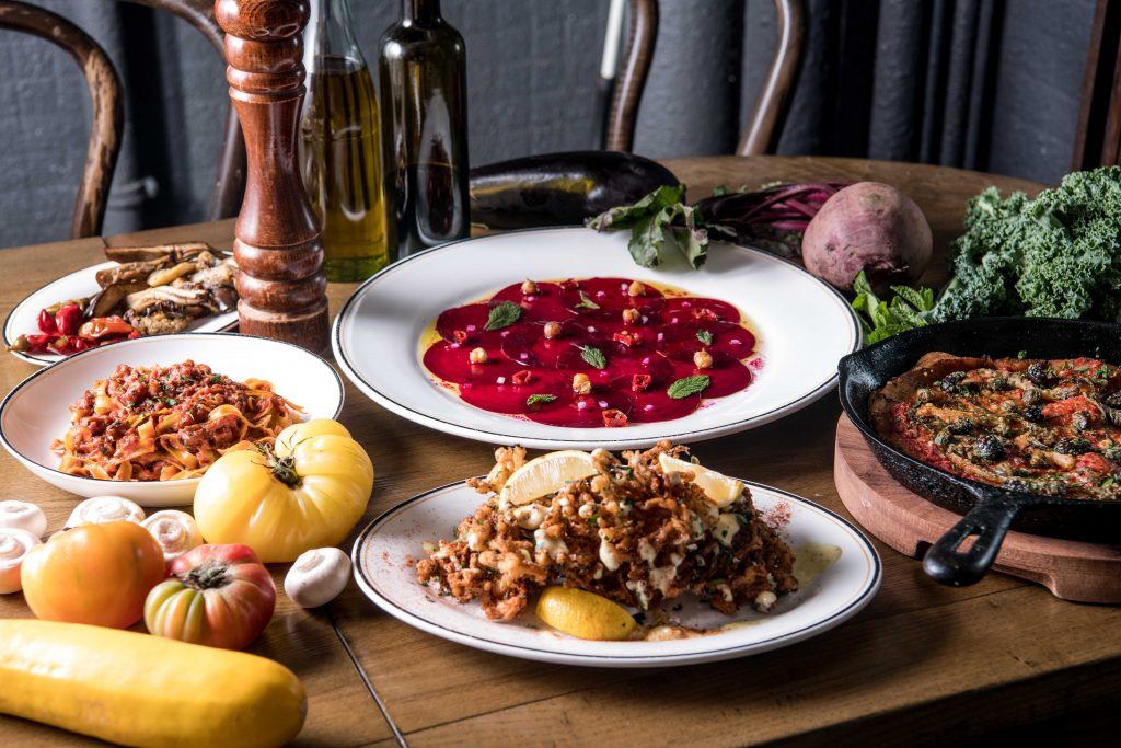 Beetroot carpaccio and other vegan dishes at Posto Pubblico in Hong Kong.