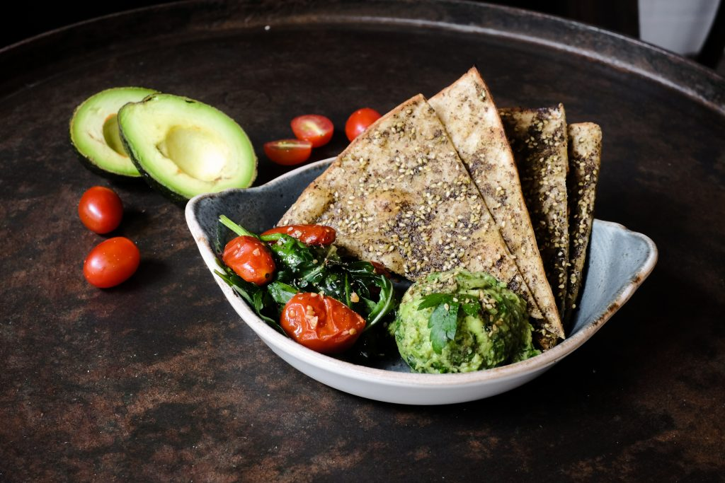 The avocado toast flatbread from Mana, part of their healthy brunch menu.