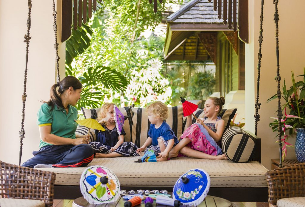 A woman sits with three children who are on a family wellness holiday at Four Season resort in Chiang Mai, Thailand.