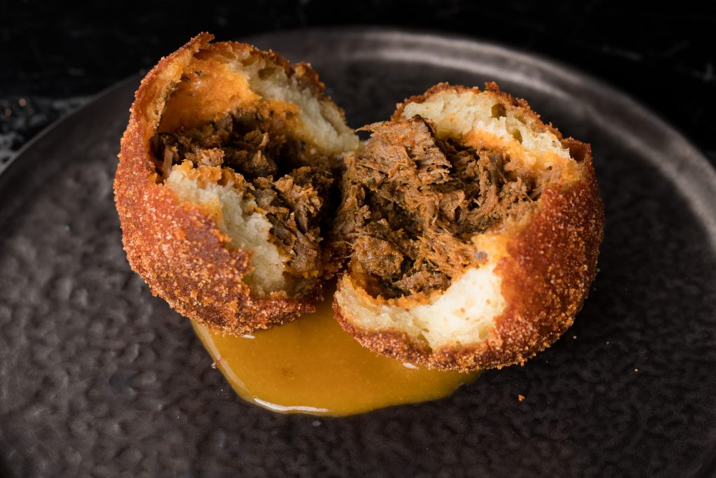 The spiced ox cheek doughnut at Duck & Waffle