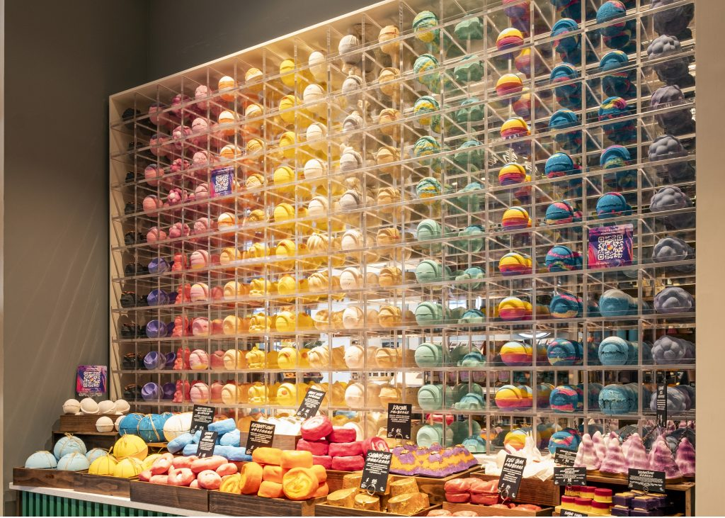 A wall of zero-waste bath bombs from Lush.