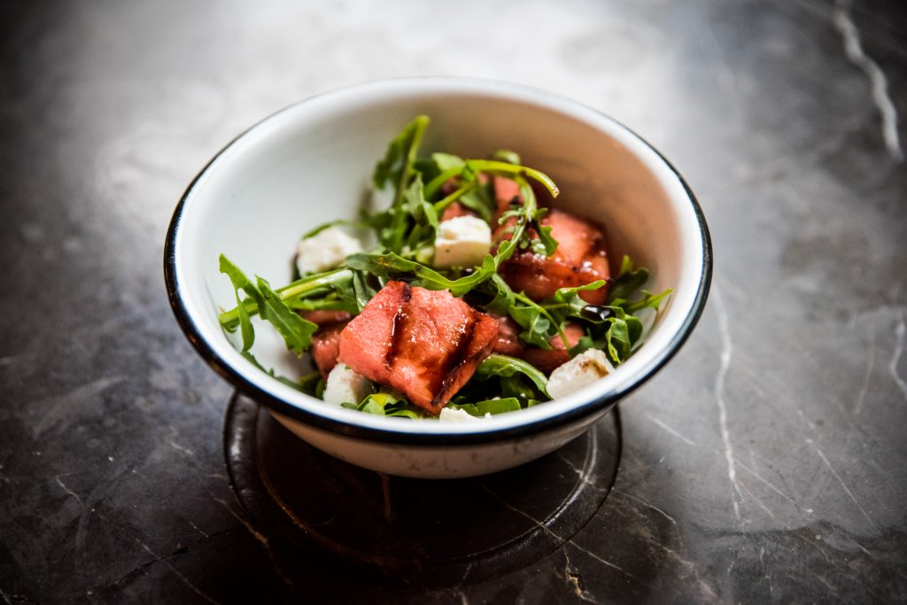 A char grilled watermelon and feta salad, with rocket and balsamic dressing.