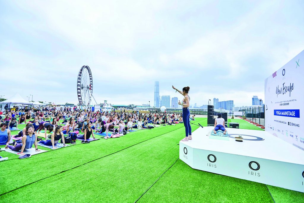 A woman leads a yoga class at IRIS wellness festival in Hong Kong