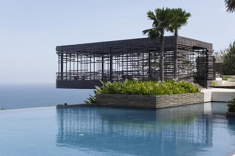 An infinity pool overlooking the ocean at Alila Villas Uluwatu, a wellness retreat in Bali.