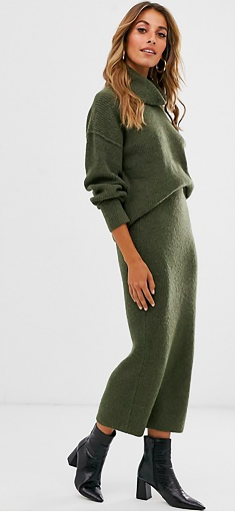 A woman in a green knitted co-ord made with recycled yarns, from ASOS.