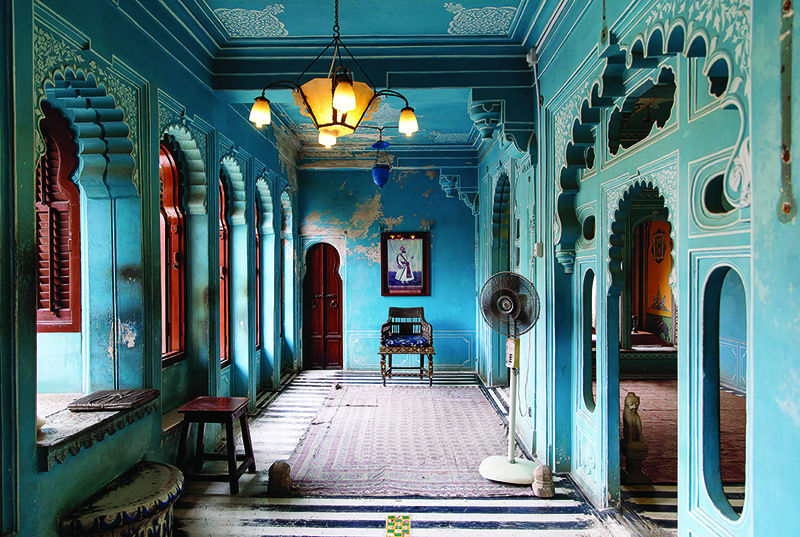 A blue foyer at a temple in India, which is a popular destination for female solo travellers in Asia.