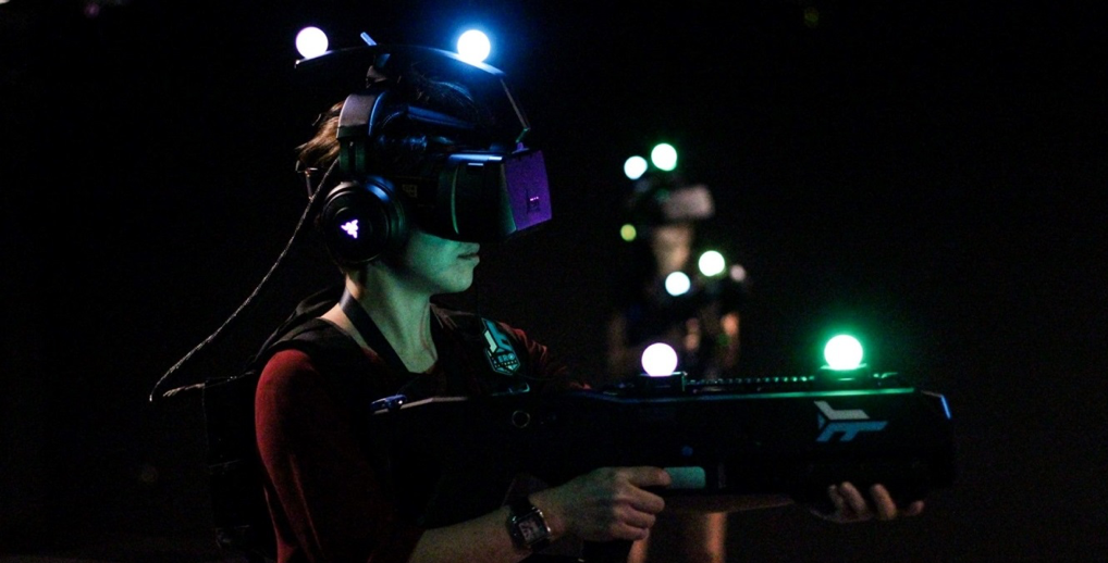 A person wears a virtual reality headset at Zero Latency in Hong Kong, a Christmas experience gift option.