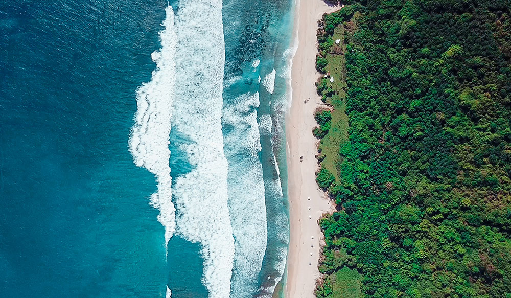 An aerial shot of Bali shoreline.