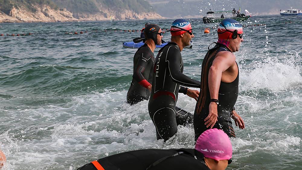 Swimmers enter the sea for the Cold Half, a wellness event and race that takes place in Hong Kong in January.