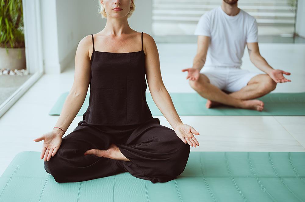 two people meditate at bliss body retreats, a hong kong yoga retreat
