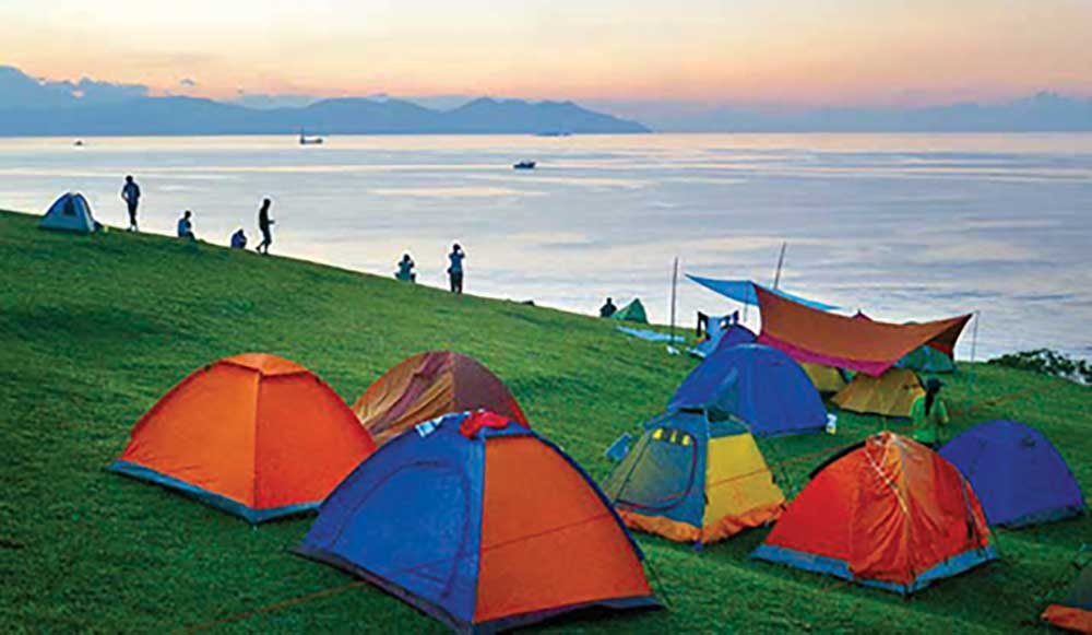 Tents on the grass at Tap Mun, a popular family-friendly campsite in Hong Kong