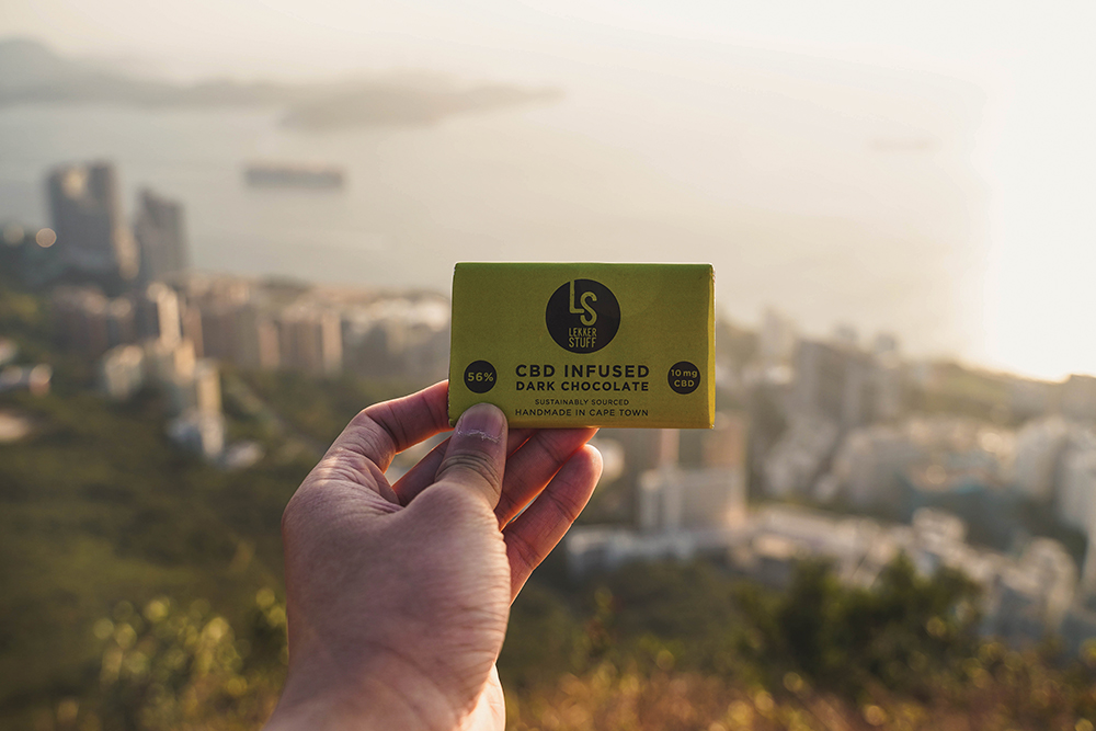A photo of a CBD chocolate bar with Hong Kong in the background